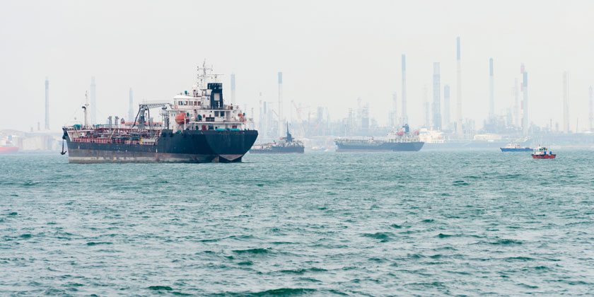 freight ships awaiting lay-up by Singapore anchorage